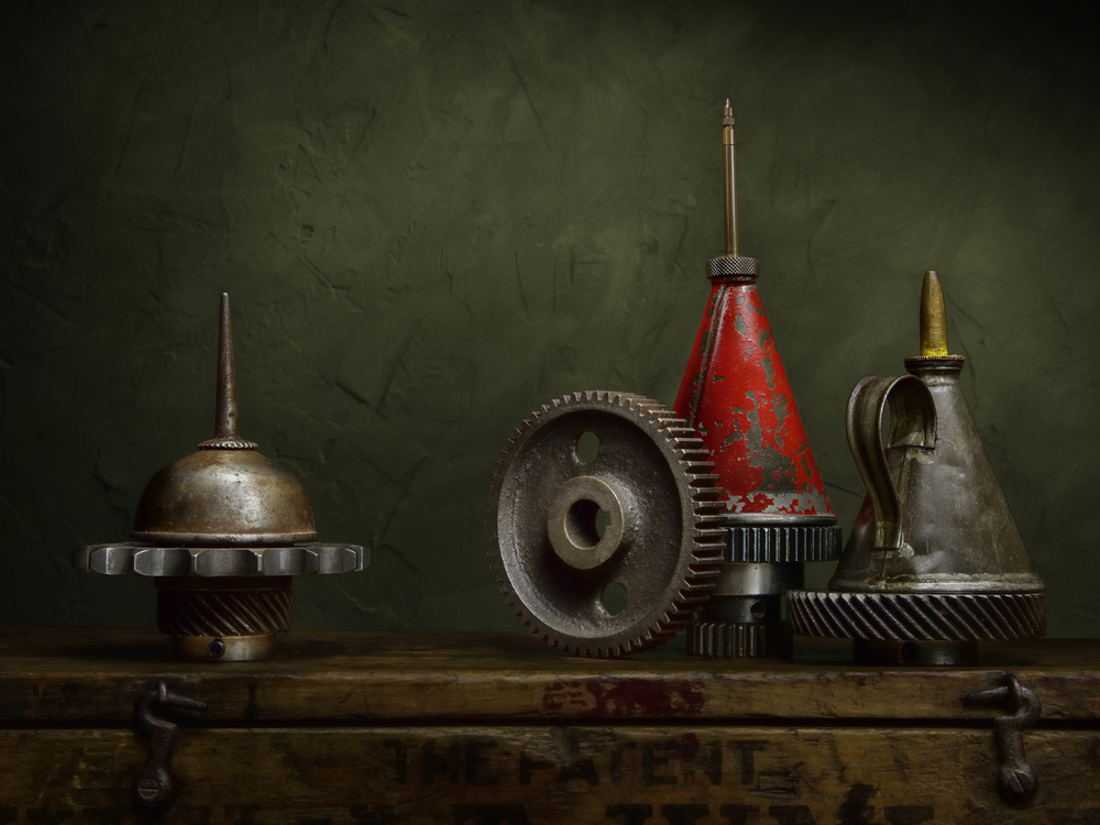 A piece of fine art art photography titled Oil Cans and Cogs by Ed Phillips