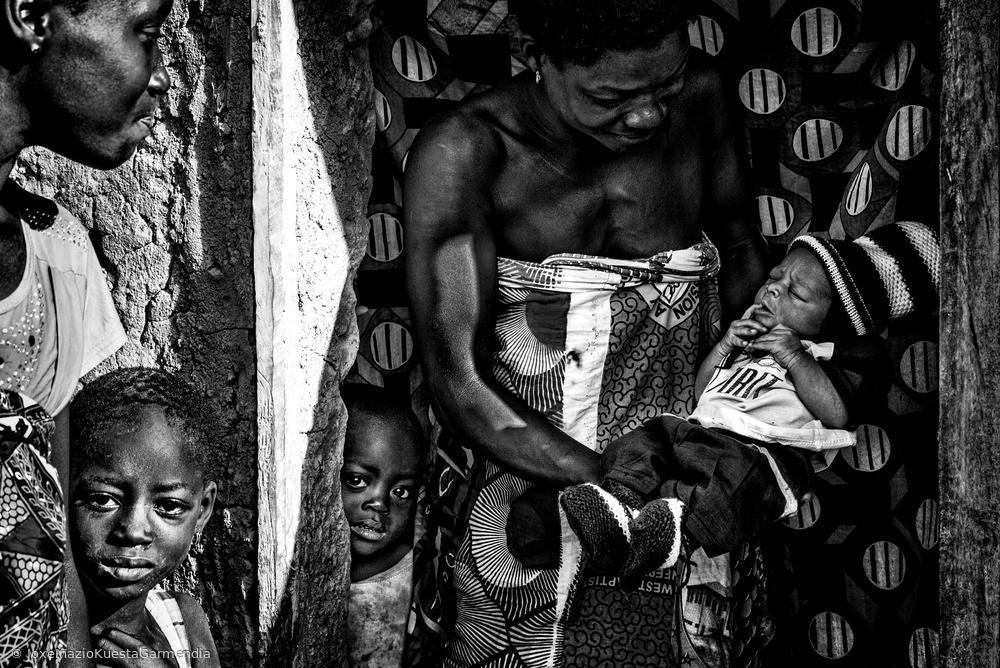 Proudly showing her newborn child - Benin