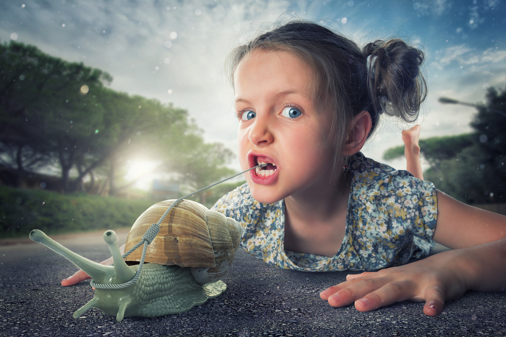 A piece of fine art art photography titled A Gentle Way to Pull Another Milk Tooth by John Wilhelm