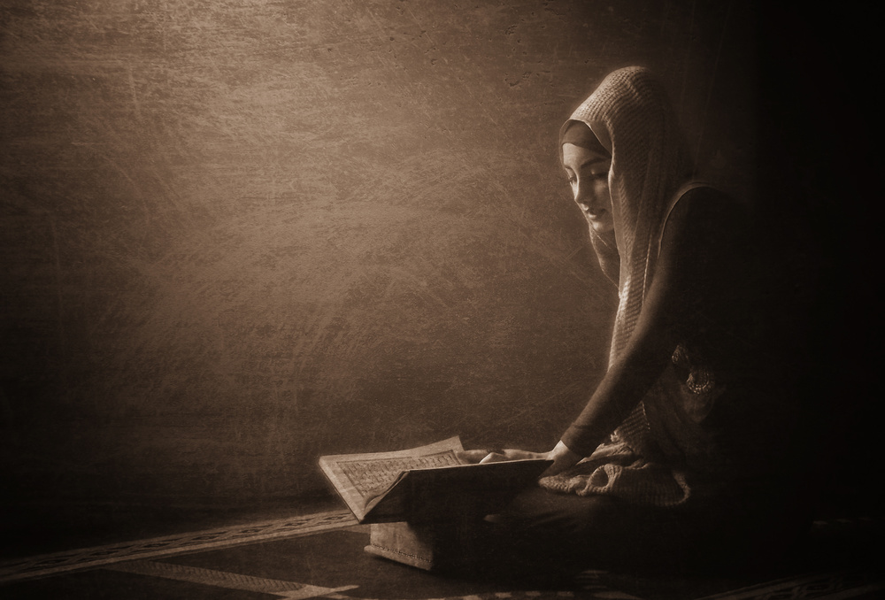 A piece of fine art art photography titled  Reading the Quran by kahar lagaa