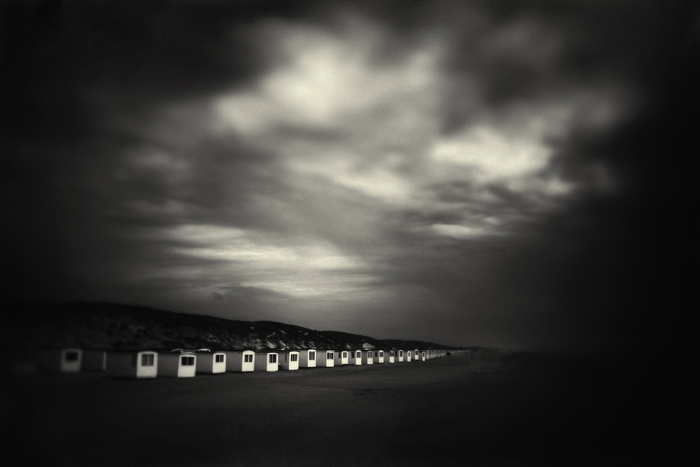 A piece of fine art art photography titled Beach Huts and Summer Skies by Marianne Siff Kusk