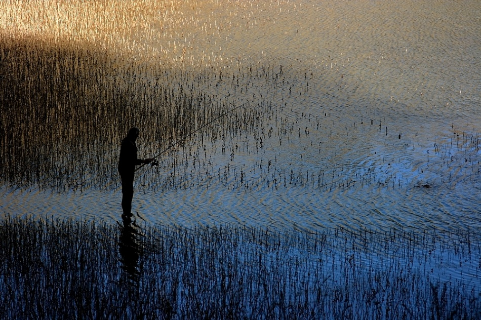 A piece of fine art art photography titled Fisherman by Rudi Kokic