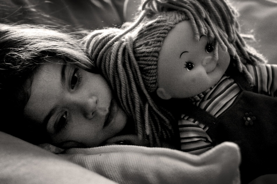A piece of fine art art photography titled Portrait With Doll by Giorgio Lorcet