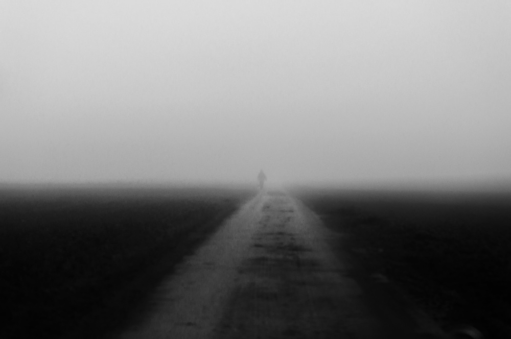 A piece of fine art art photography titled Lonely Walker In the Mist by Eddy Verloes