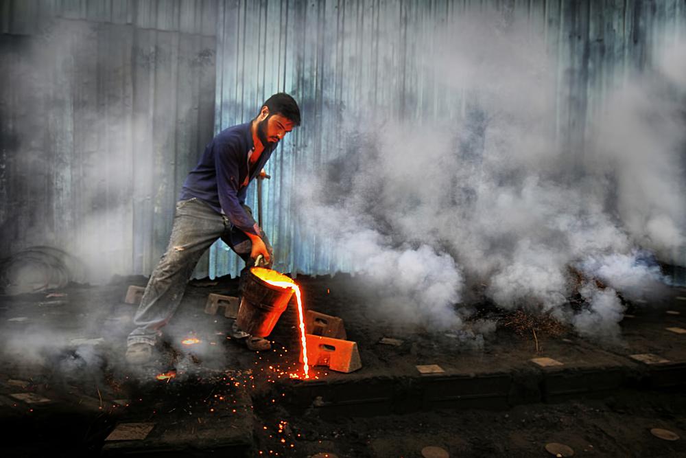 A piece of fine art art photography titled Fire Worker by Emine Basa