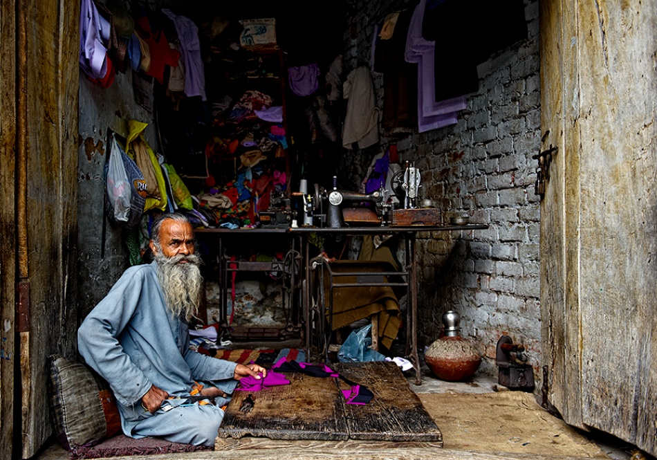 A piece of fine art art photography titled Tailor Master by Prateek Dubey
