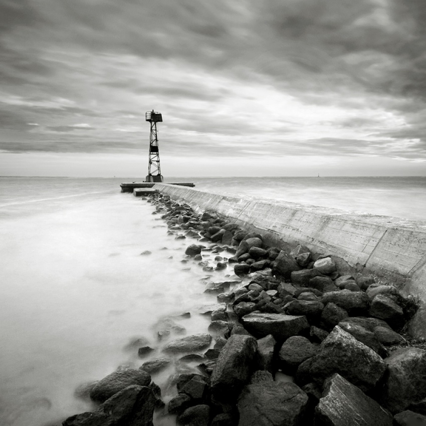 A piece of fine art art photography titled Breakwater by Maciej Koniuszy