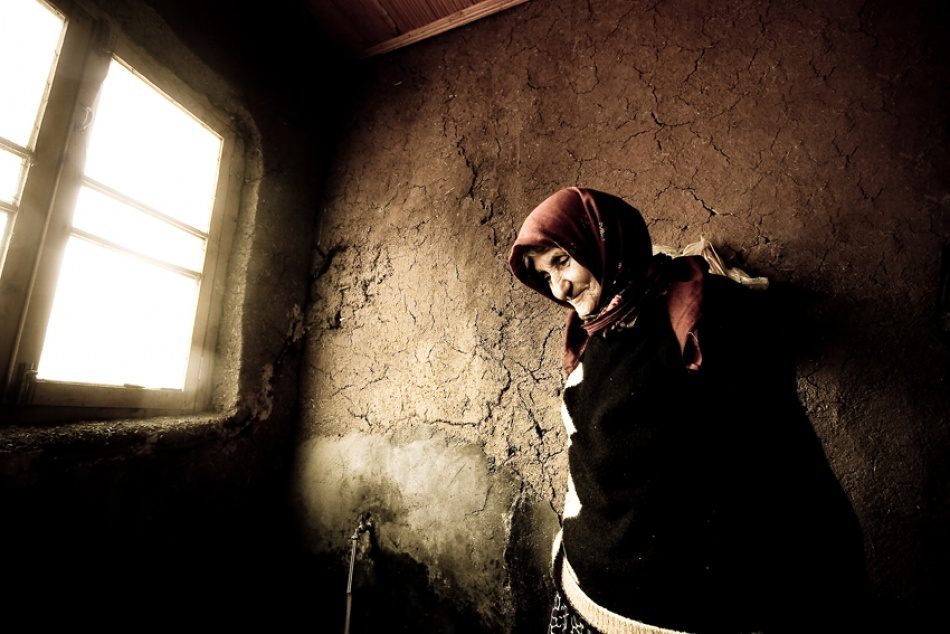 Time passing through a window with an old woman beyond it inviting the world to smile