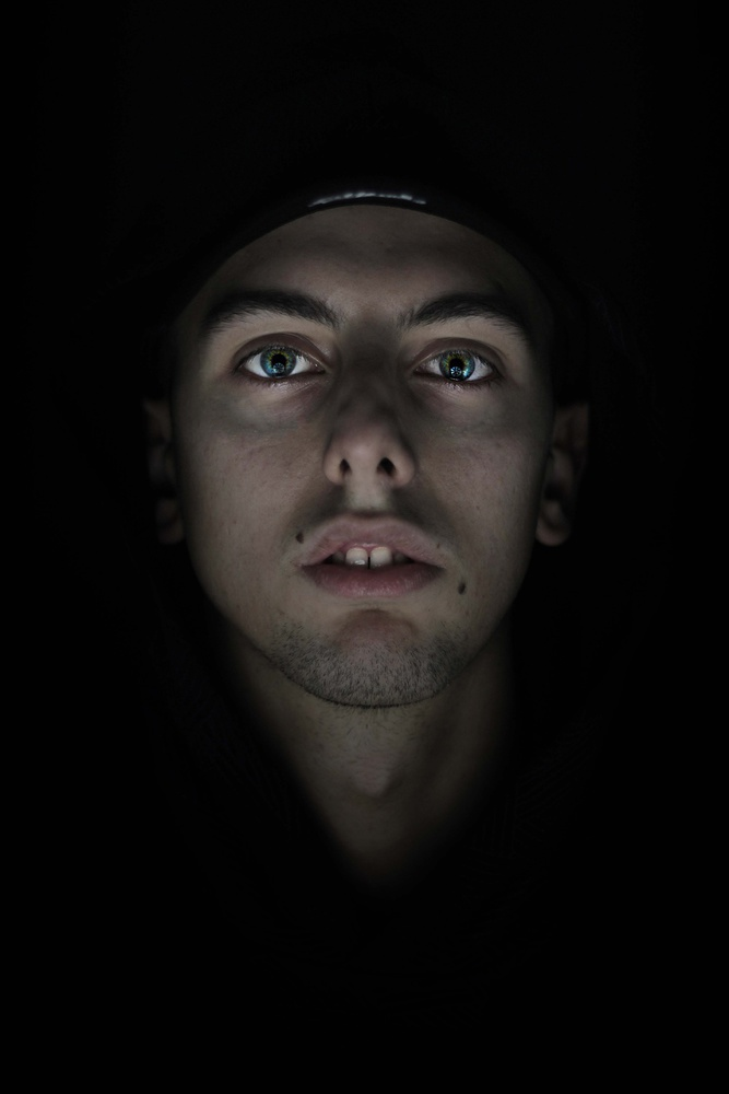 Low light, green eyes