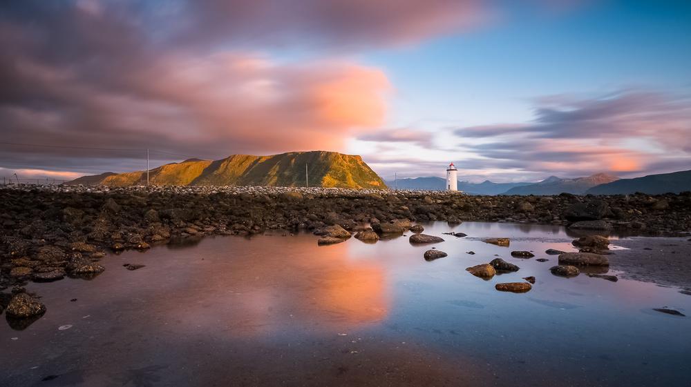 A piece of fine art art photography titled Lighthouse by Tomasz Orylski