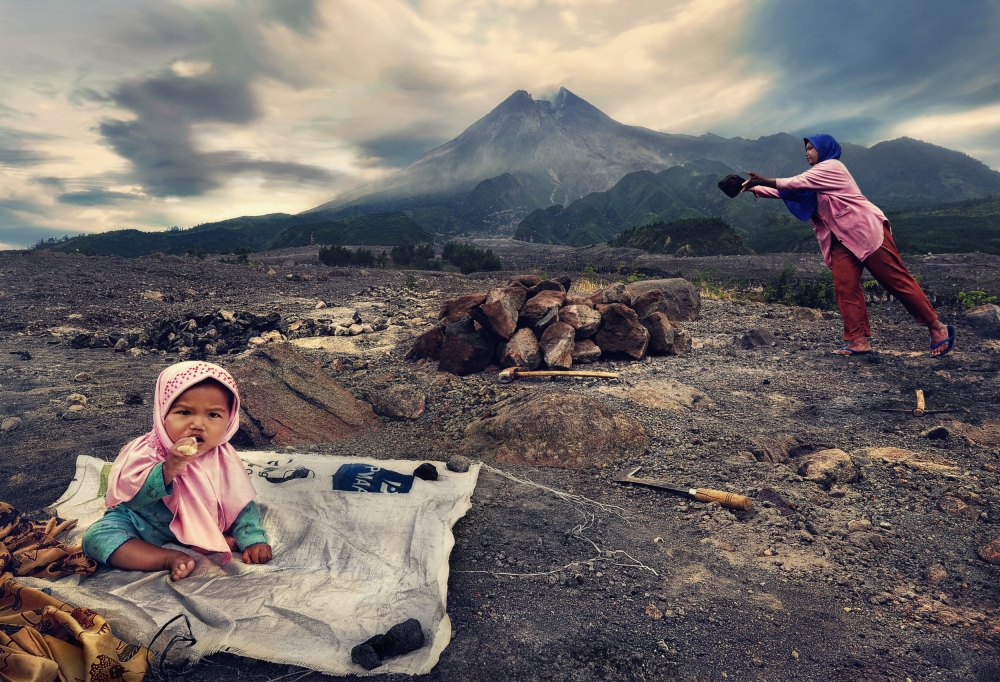 Waiting for Mommy Collecting Stones at Merapi