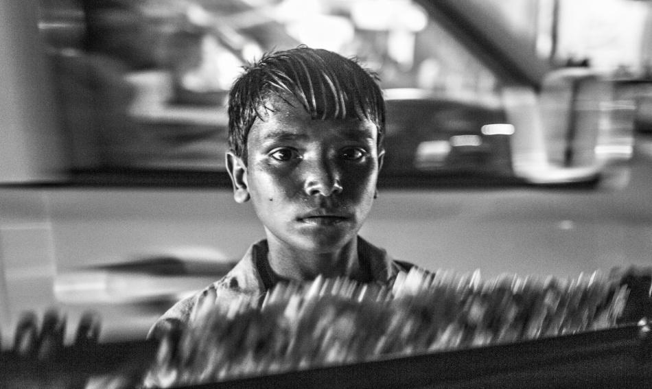 A piece of fine art art photography titled Boy In Gulshan by Jan Møller Hansen