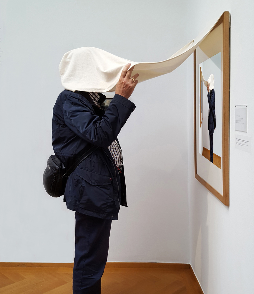 A piece of fine art art photography titled Watching His Selfie at the Museum! by Huib Limberg