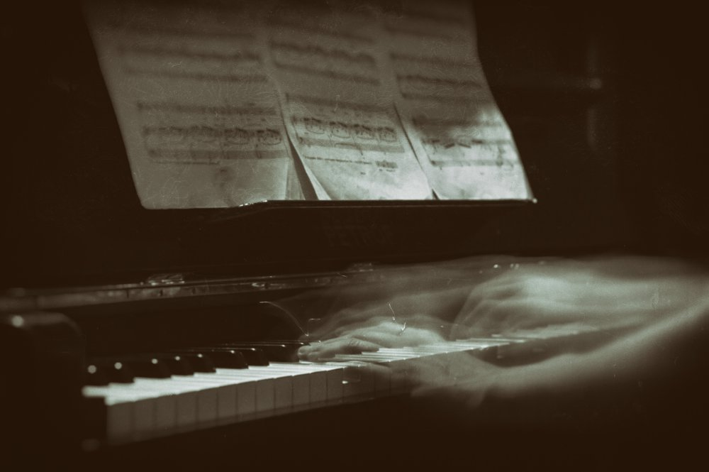 A piece of fine art art photography titled Play the Piano by Zaom Eighty