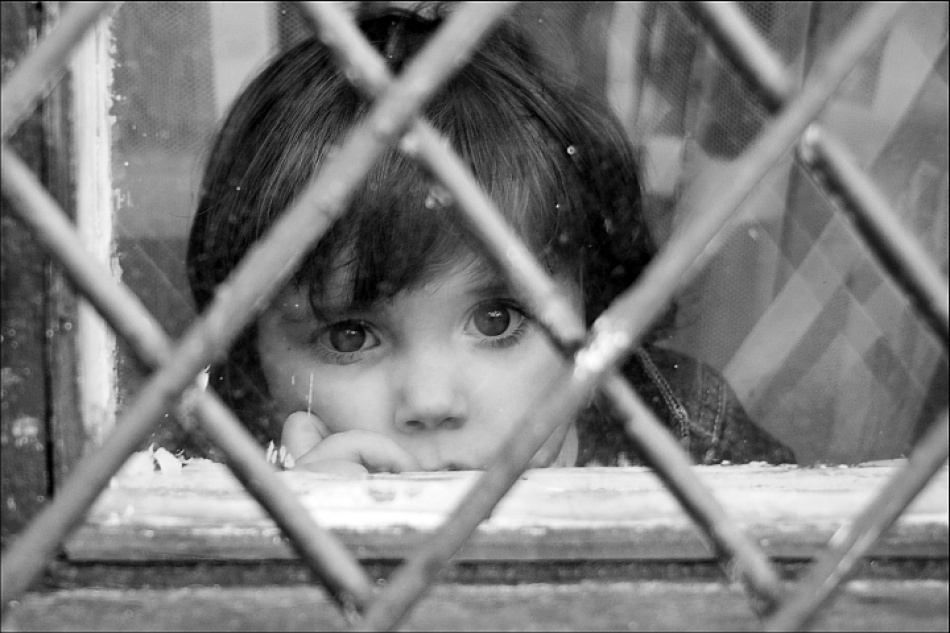 A piece of fine art art photography titled Child at Window by Bogdan Sandulescu