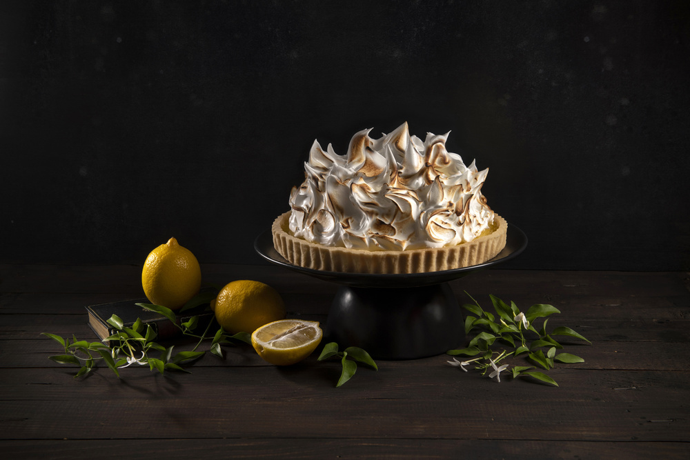 View this piece of fine art photography titled Is there too much meringue on the lemon cake? by Udo Dittmann