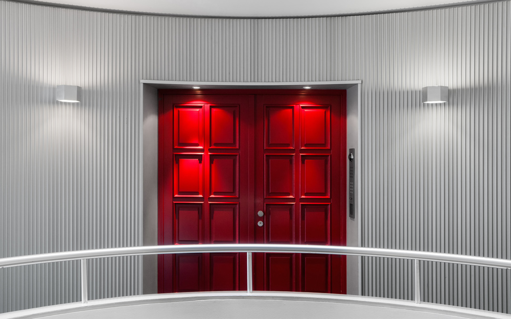 A piece of fine art art photography titled The Red Door by Harry Lieber