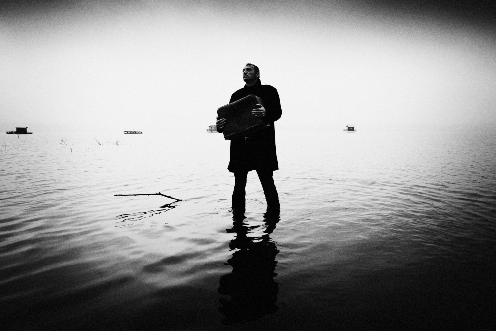 A piece of fine art art photography titled Man and Lake by amir bajrich