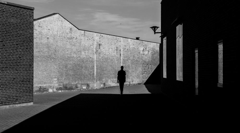 A piece of fine art art photography titled Walking Into the Darkness by Inge Schuster