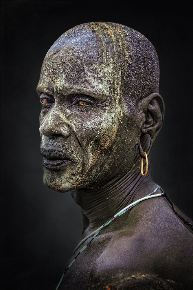 A piece of fine art art photography titled African Portrait Mursi by Svetlin Yosifov