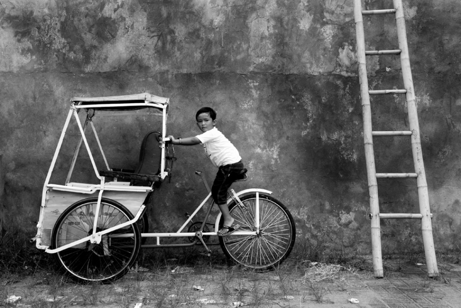 A piece of fine art art photography titled On the Becak by Wawan Setiawan