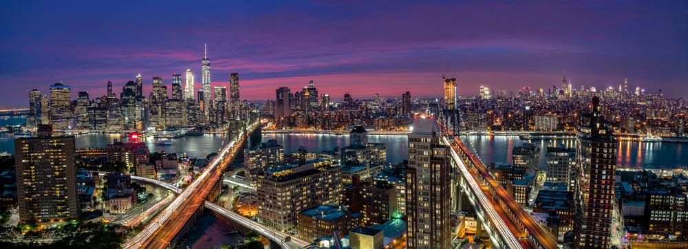 A piece of fine art art photography titled Manhattan Skyline During Beautiful Sunset by Thomas D Mørkeberg