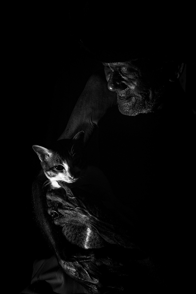 A piece of fine art art photography titled With His Cat by Andi Halil