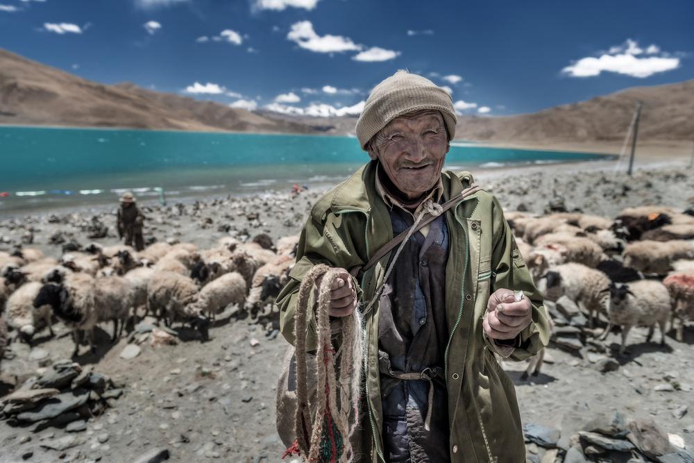 A piece of fine art art photography titled Smile Shepherd (Tibetan) by sarawut intarob