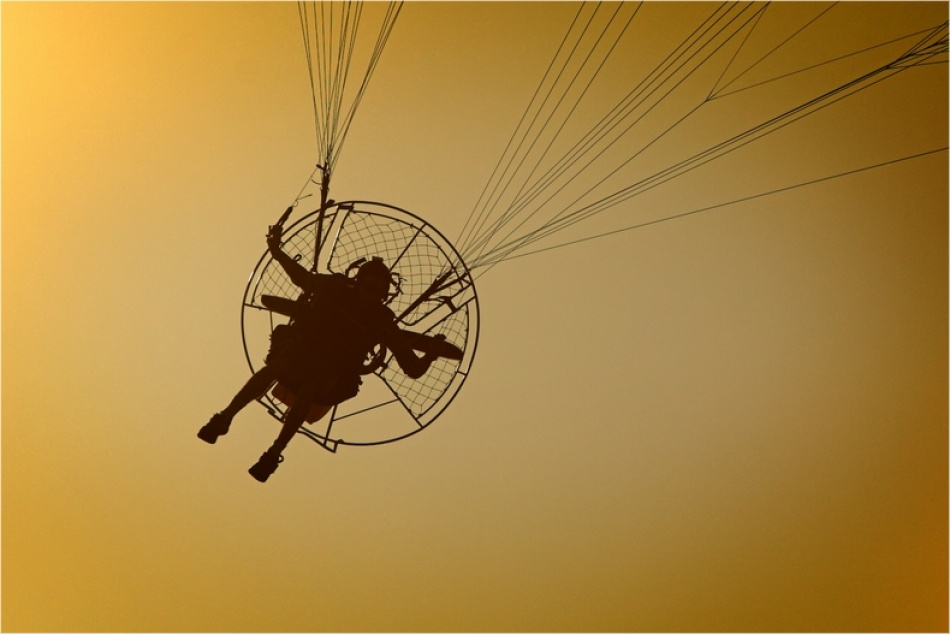 A piece of fine art art photography titled Paramoteur by Armel COUETTE