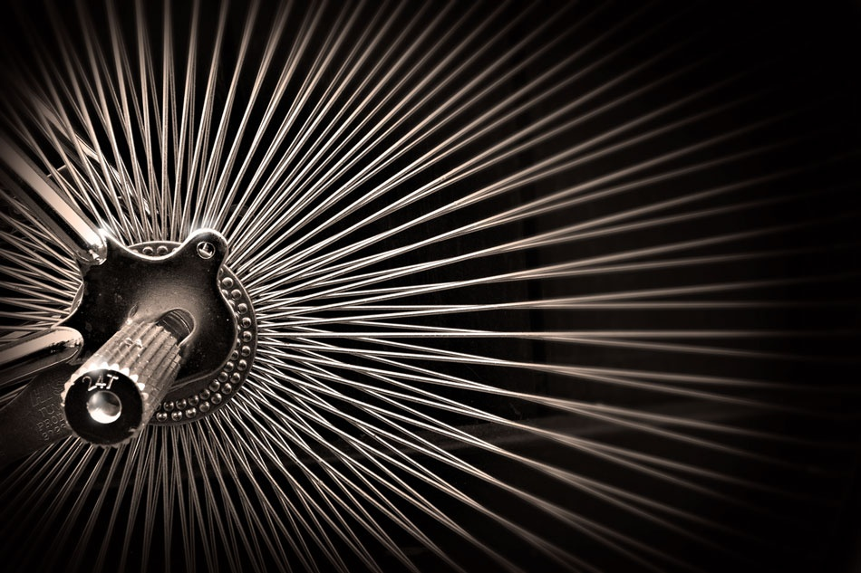 A piece of fine art art photography titled Kinetic Spokes by Patricia Sweeney
