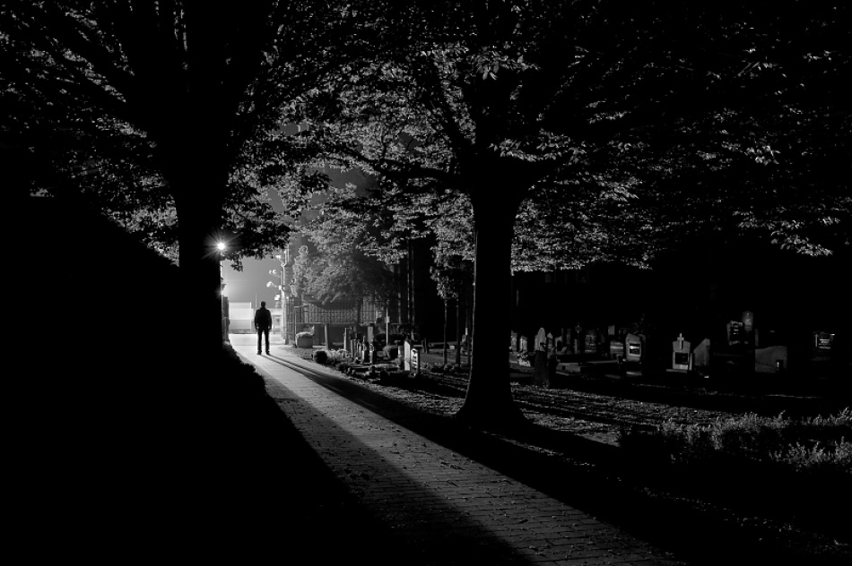 A piece of fine art art photography titled The Cemetery II by Tim Corbeel