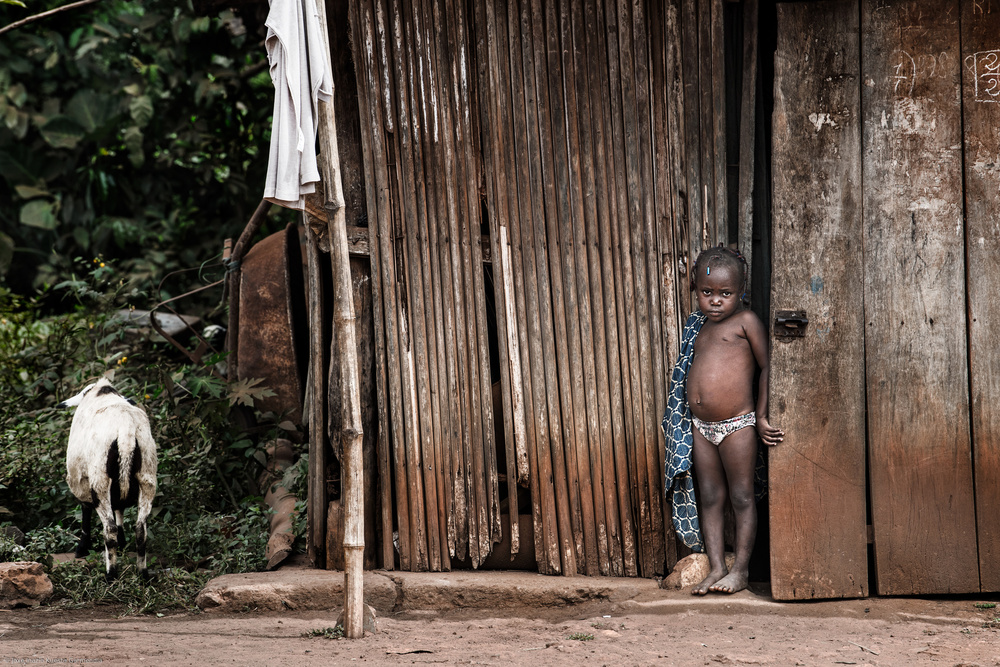View this piece of fine art photography titled The child and the sheep - Benin by Joxe Inazio Kuesta Garmendia