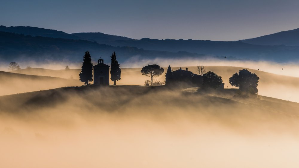 A piece of fine art art photography titled Foggy Dawn In Val D'Orcia by Robert Debreczeni