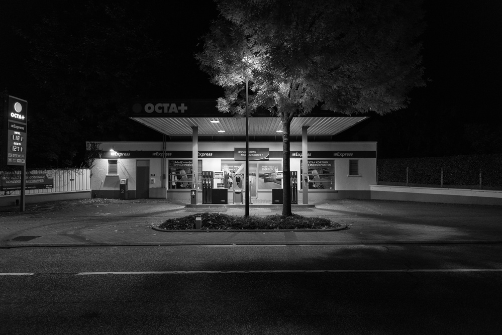 A piece of fine art art photography titled Gas Station by Eddy Verloes