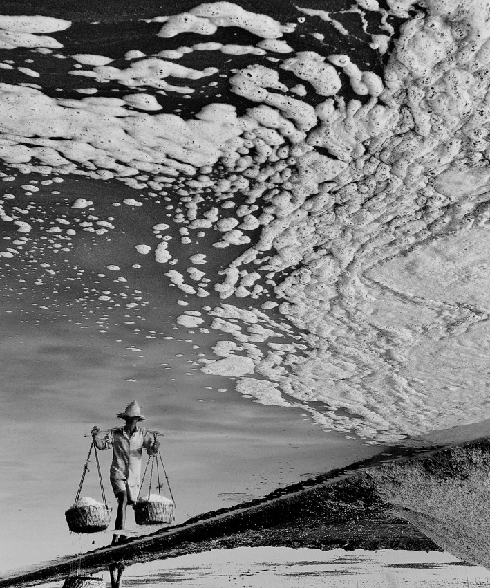 A piece of fine art art photography titled Reflection of Salt Farmer by Zulkarnain Katili