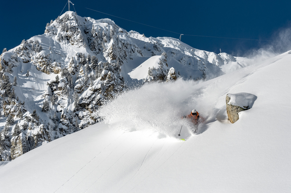 A piece of fine art art photography titled Powder Turn With Romain Grojean by Tristan Shu