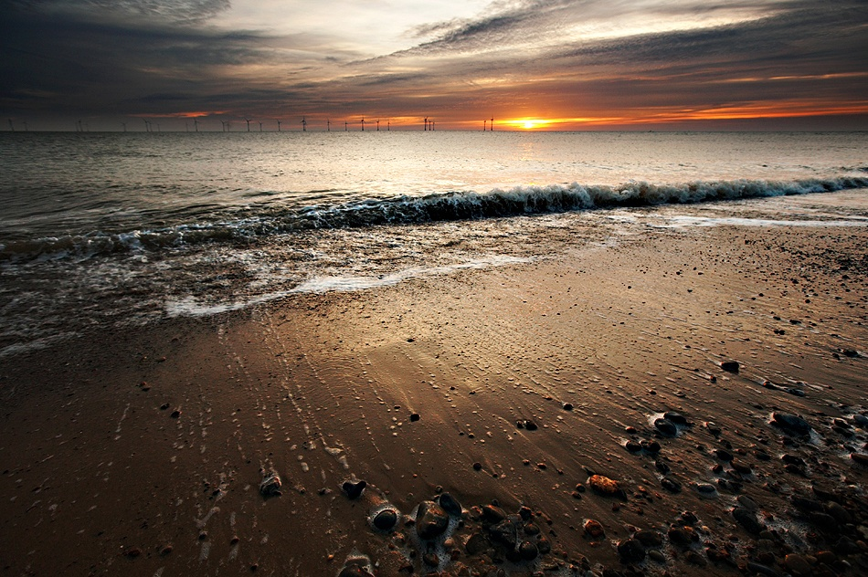 A piece of fine art art photography titled Windfarm Sunrise by Duncan Kerridge