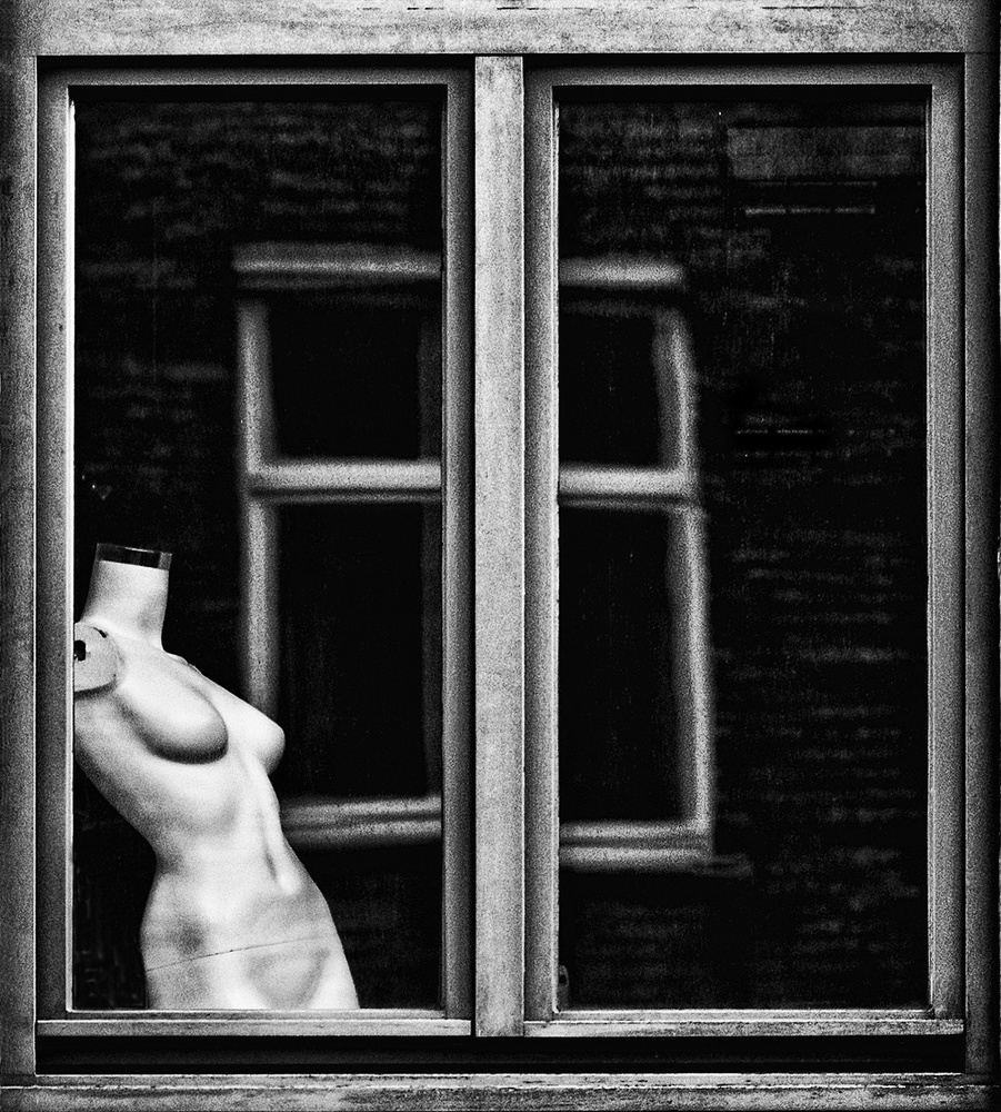 A piece of fine art art photography titled Mannequin Window by Susanne Stoop