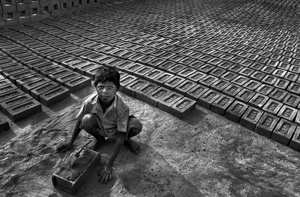 A piece of fine art art photography titled Daily Labour by Avishek Das