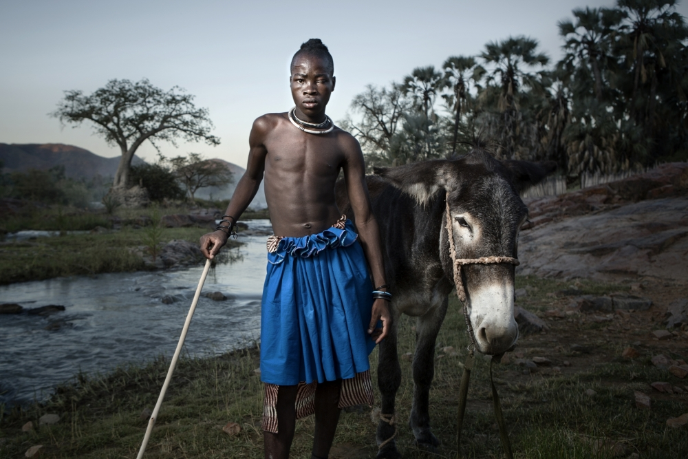 A piece of fine art art photography titled Katusa & His Donkey by Ben McRae
