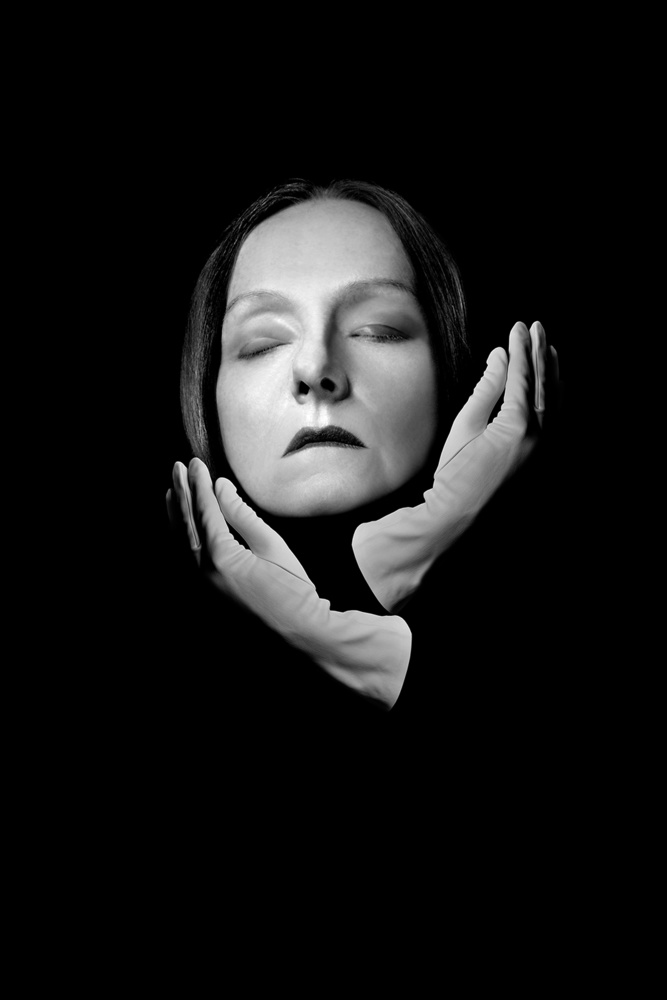A piece of fine art art photography titled Portrait In White Gloves by Małgorzata Kossakowska