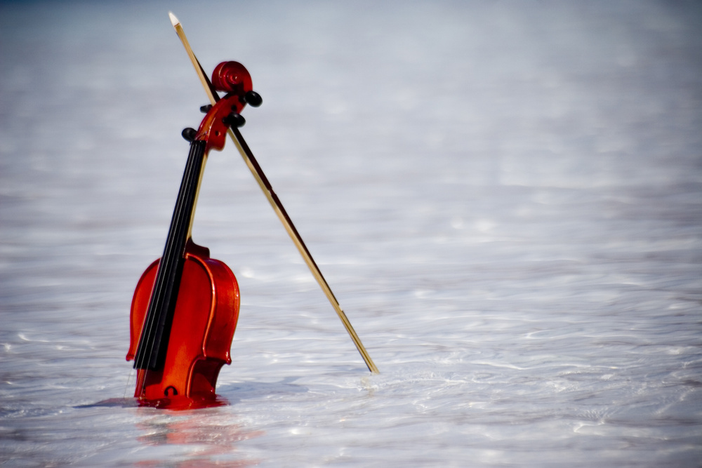 A piece of fine art art photography titled The Violin In the Water by ahmet orhan