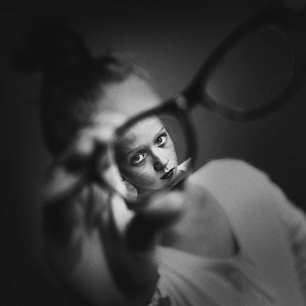 A piece of fine art art photography titled Through His Glasses by Kharinova Uliana