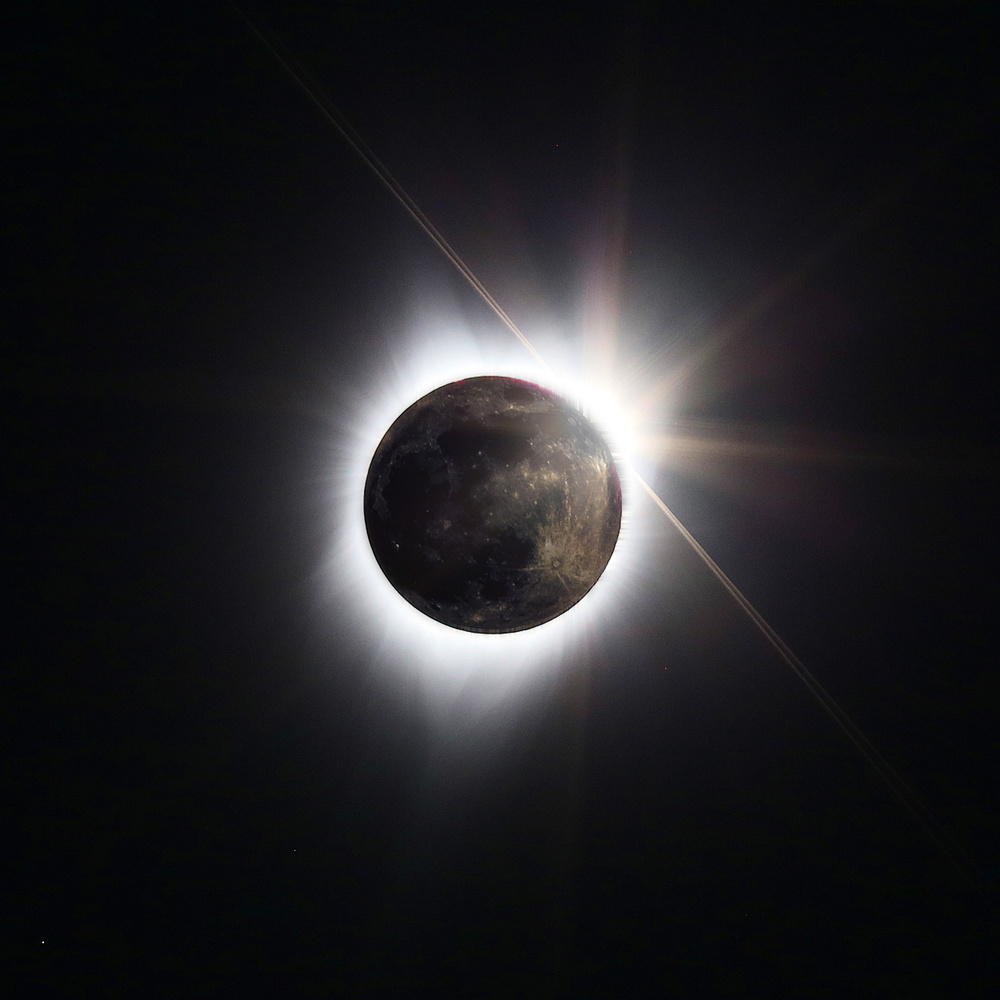 A piece of fine art art photography titled Full Moon + Totality by Randall Osterhuber