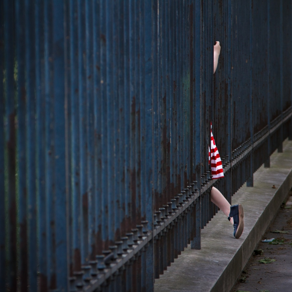 A piece of fine art art photography titled Girl In Striped Red Dress by Veronica Gonzalez Vanek