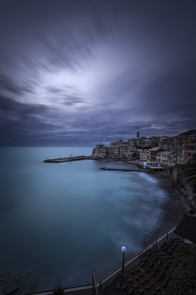 A piece of fine art art photography titled The Slight Movement of the Clouds On the Emerald Sea by Enrico Cusinatti