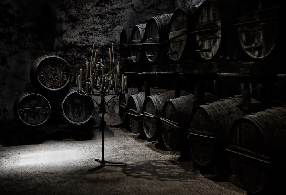 A piece of fine art art photography titled The Dark Atmosphere of an Old Wine Cellar by Hans-Wolfgang Hawerkamp