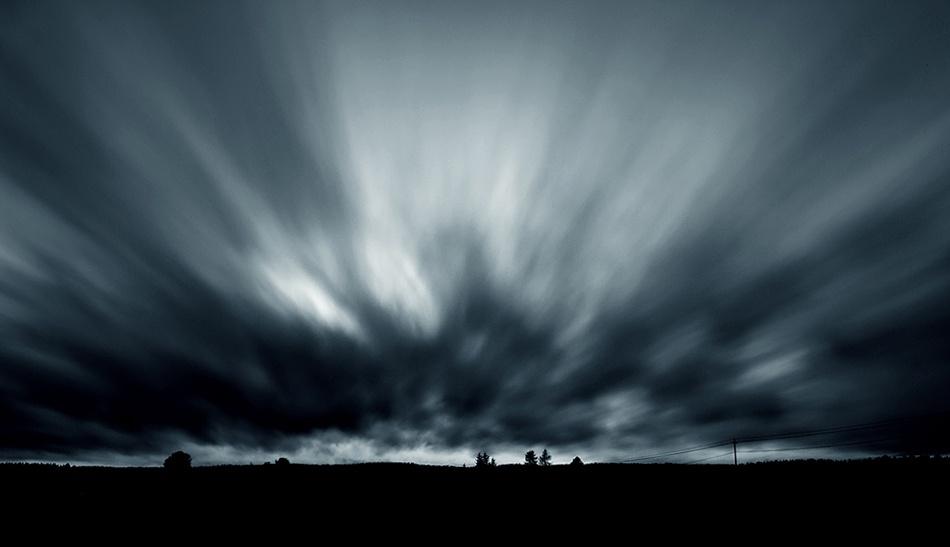 A piece of fine art art photography titled Sky In Motion by Joni Niemelä