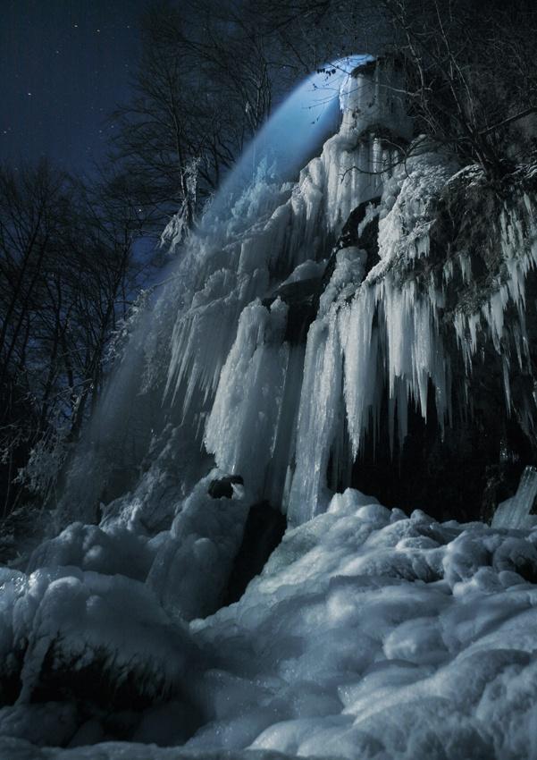 A piece of fine art art photography titled Eisfall Im Mondlicht by Nicolas Schumacher