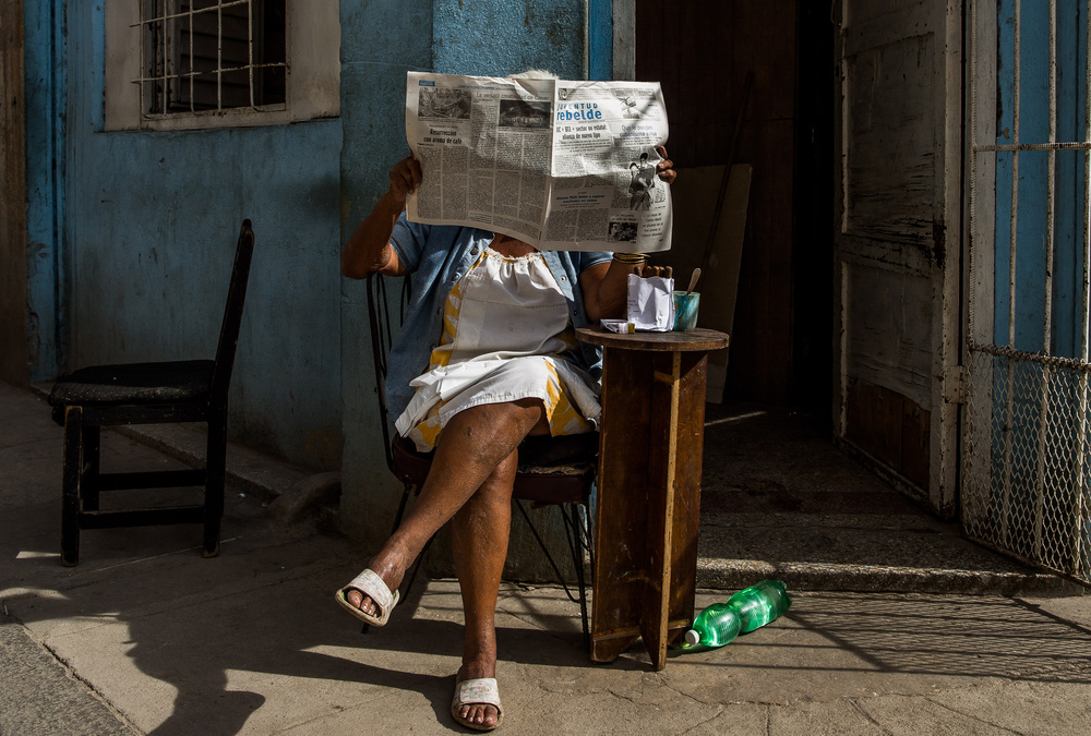 A piece of fine art art photography titled Hidden Behind the Newspaper by Inge Schuster